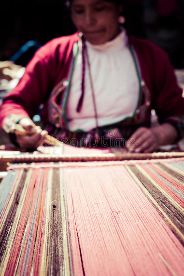 Traditional hand weaving in the Andes Mountains, Peru stock images