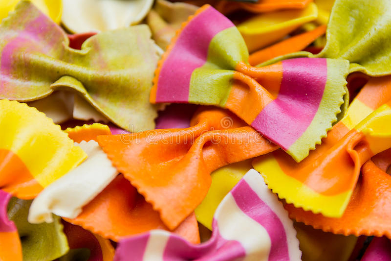 Traditional handmade italian farfalle pastas. Close up colored background royalty free stock photography