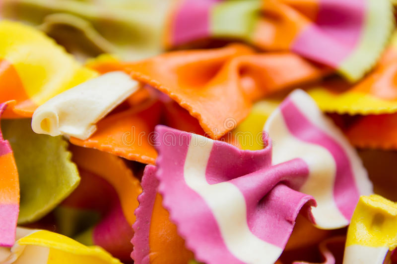 Traditional handmade italian farfalle pastas. Close up colored background royalty free stock photo
