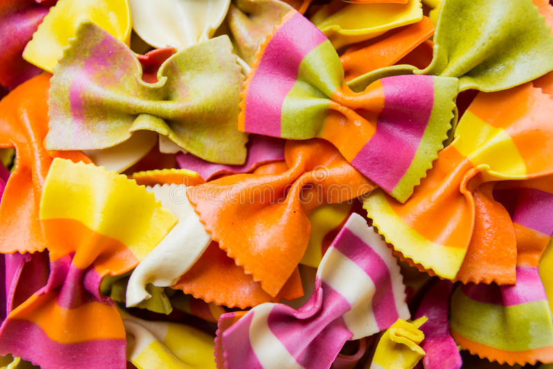 Traditional handmade italian farfalle pastas. Close up colored background stock photos
