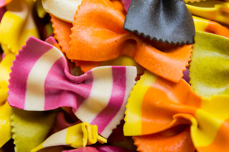Traditional handmade italian farfalle pastas. Close up colored background royalty free stock images