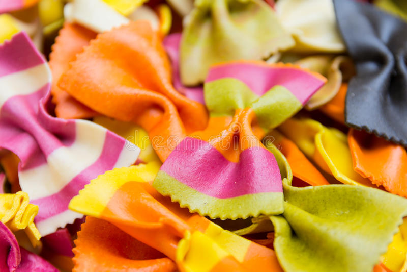 Traditional handmade italian farfalle pastas. Close up colored background stock photo