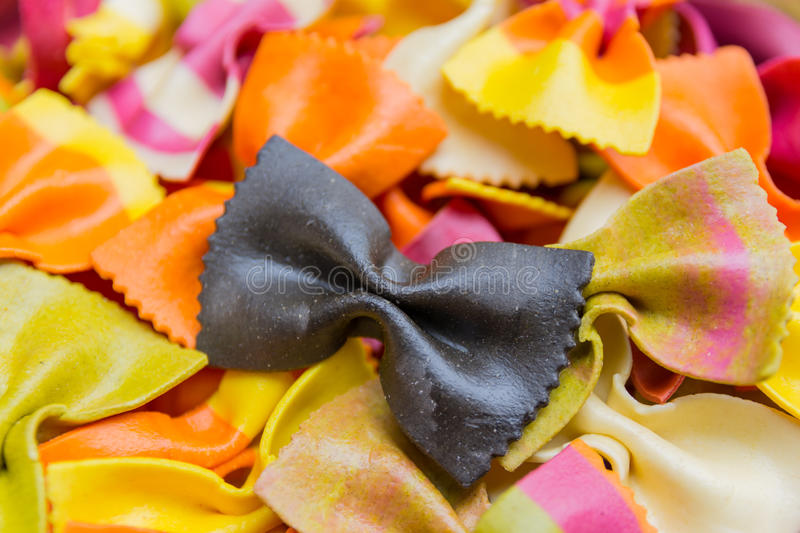 Traditional handmade italian farfalle pastas. Close up colored background stock photography