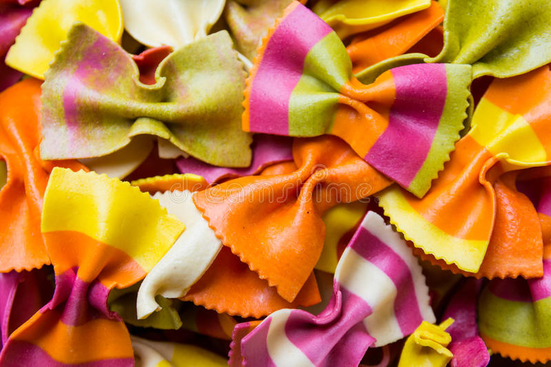 Traditional handmade italian farfalle pastas. Close up colored background stock images