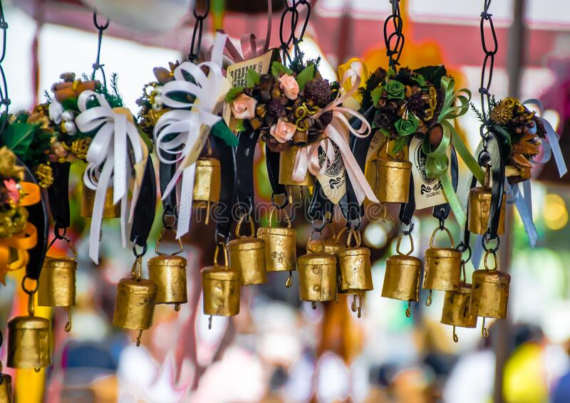 Traditional hanging bells for sale in a market in Salzburg in Austria. Traditional hanging bells for sale in a local market in Salzburg in Austria stock photography