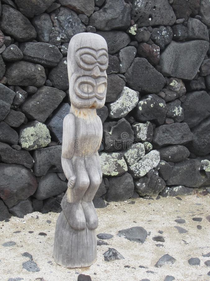 Traditional Hawaiin Wood Sculpture. Traditional ancient wood sculpture representing the early Hawaiin culture of the Big Island of Hawaii royalty free stock photos