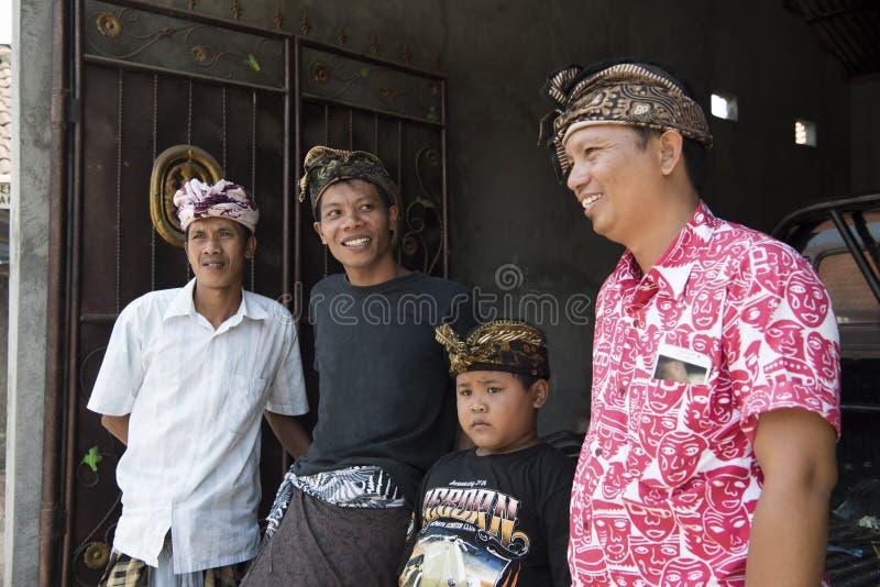 Traditional headdressed Balinese men stock image