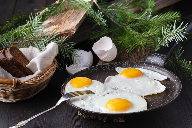 Traditional healthy easy quick breakfast meal made of two fried eggs served on a frying pan stock photo