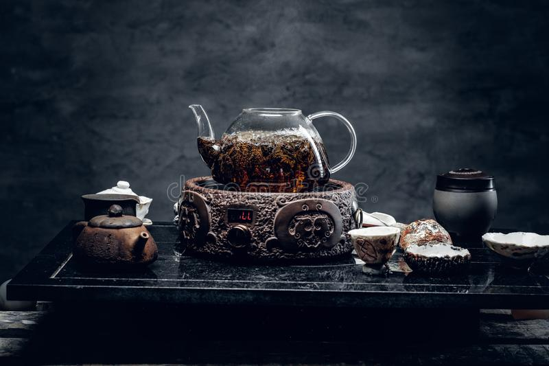 Traditional herbal tea in transparent glass teapot. Studio shot royalty free stock image