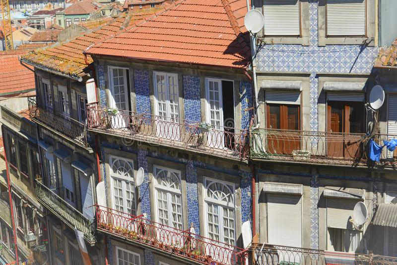Traditional historic facade in Porto blue tiles. Historic facade in Porto decorated with blue hand painted tin-glazed tiles azulejo Porto, Portugal royalty free stock photography