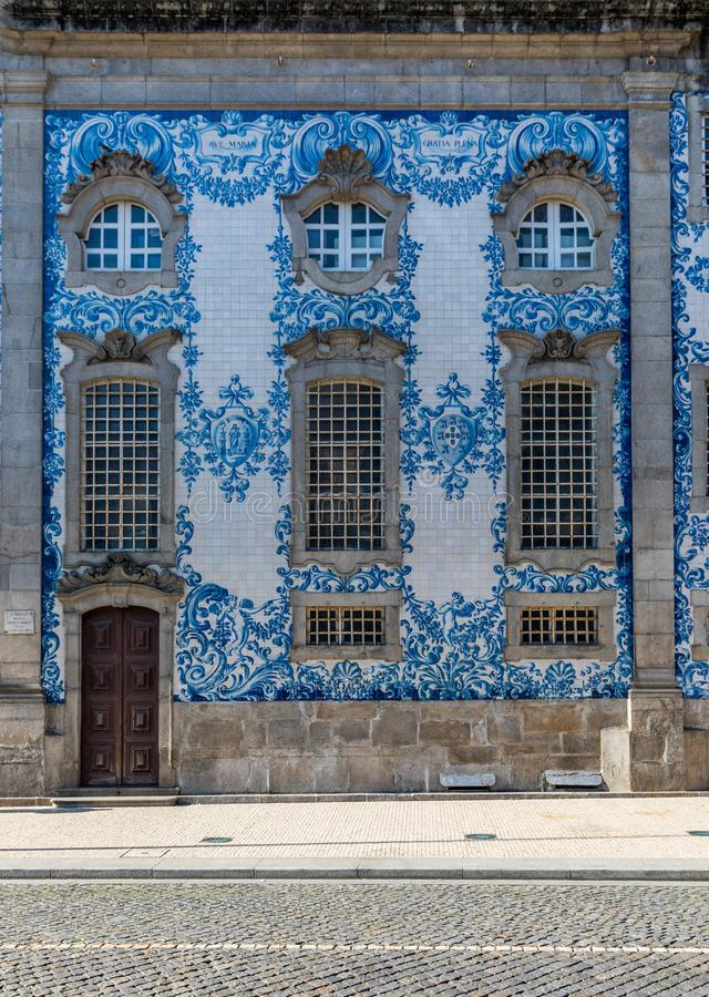 Traditional historic facade in Porto decorated with blue hand painted tin-glazed tiles, Oporto, Portugal royalty free stock photo