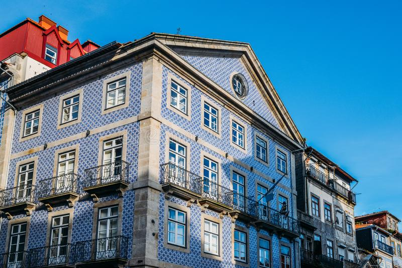 Traditional historic facade in Porto decorated with blue tiles, Portugal stock photography