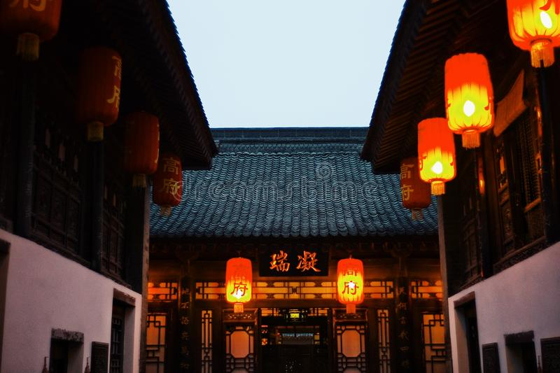 Traditional historical chinese village, buildings with lanterns at dawn stock photos