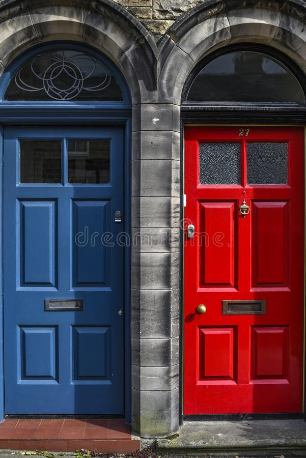 Traditional home door in England in red and blue royalty free stock image
