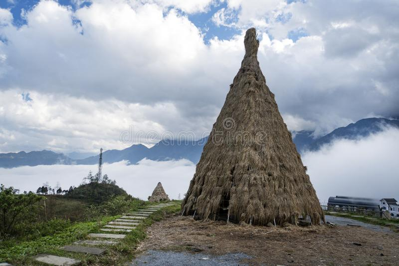 Traditional home of small peoples of North Vietnam, living in the mountains near the city of Sapa. Historical reconstruction. Installation. Ancient straw stock image