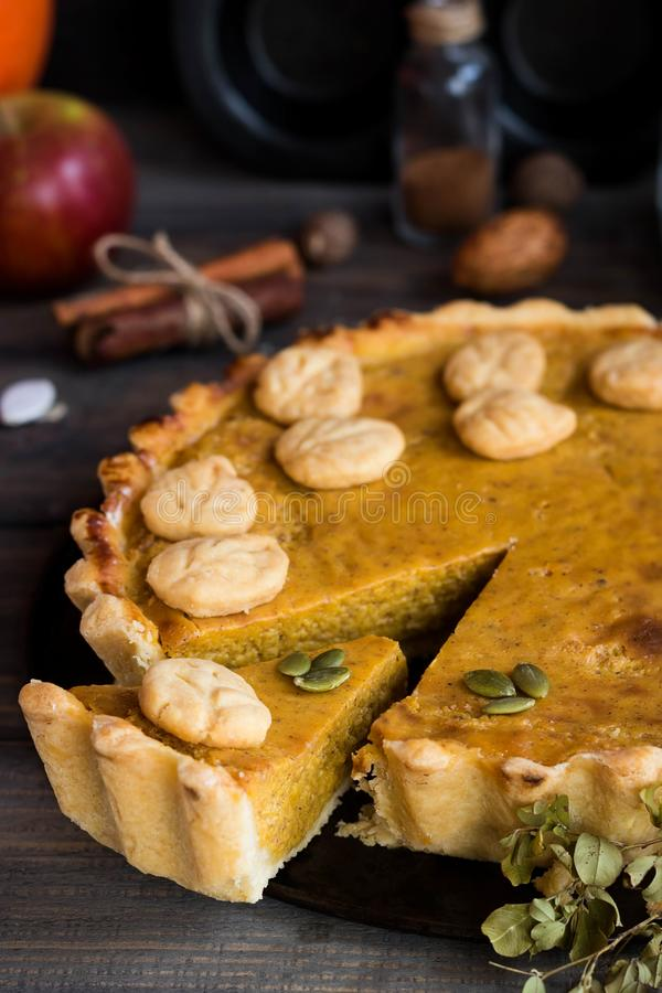 Traditional homemade American pumpkin pie with a decor of a cookie in the form of leaves for a holiday. stock images
