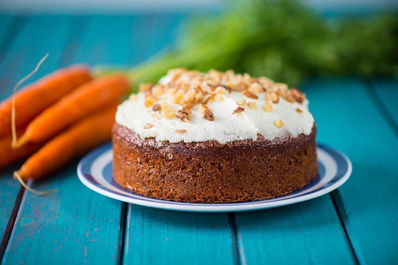 Traditional homemade carrot cake and fresh carrots stock images