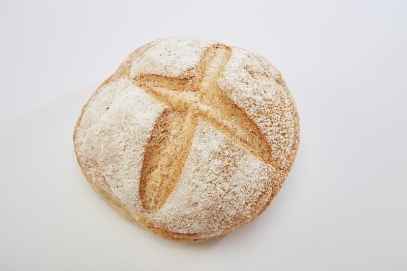 Traditional homemade french round bread. On a white background stock images