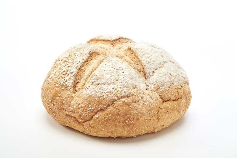 Traditional homemade french round bread. On a white background royalty free stock photos