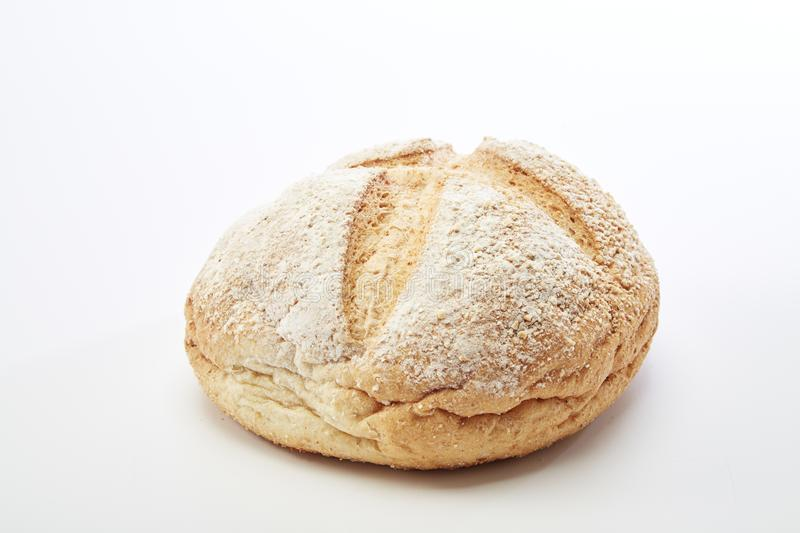 Traditional homemade french round bread. On a white background royalty free stock photography