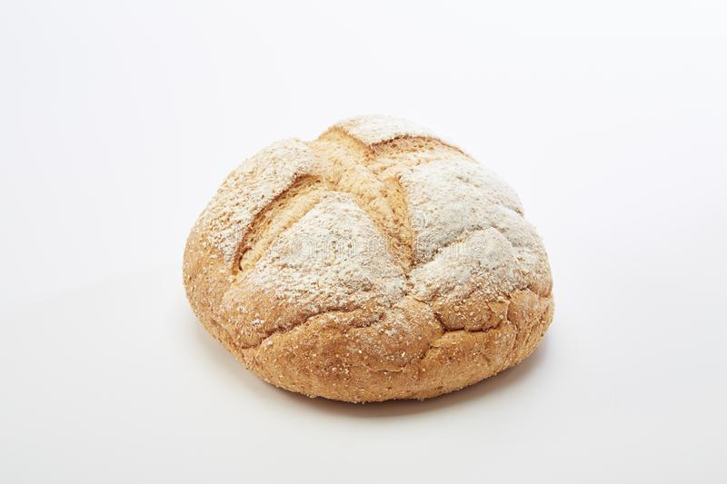 Traditional homemade french round bread. On a white background royalty free stock photo