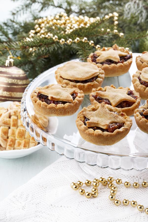 Traditional homemade fruit mince pies in Christmas decoration royalty free stock photography