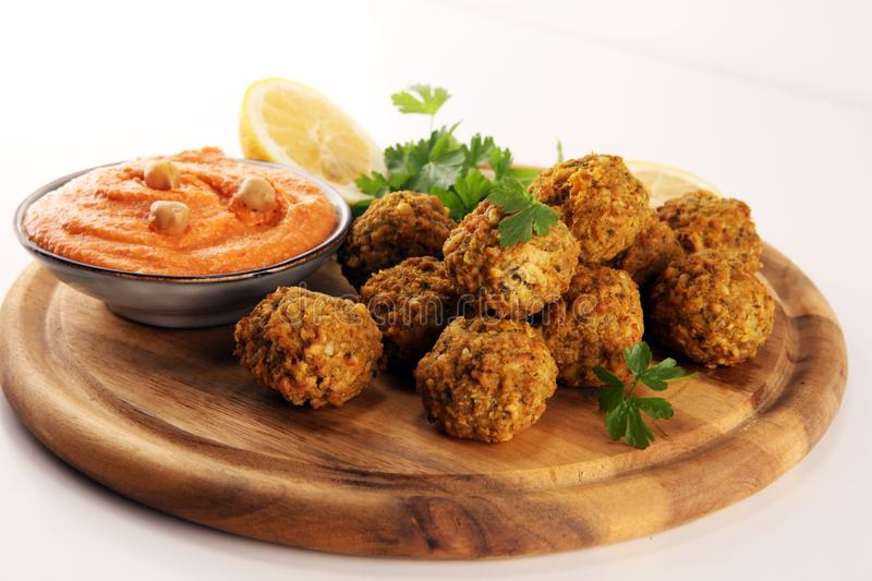 Traditional homemade hummus, falafel and chickpea served with spices on table. Jewish Cuisine stock photos
