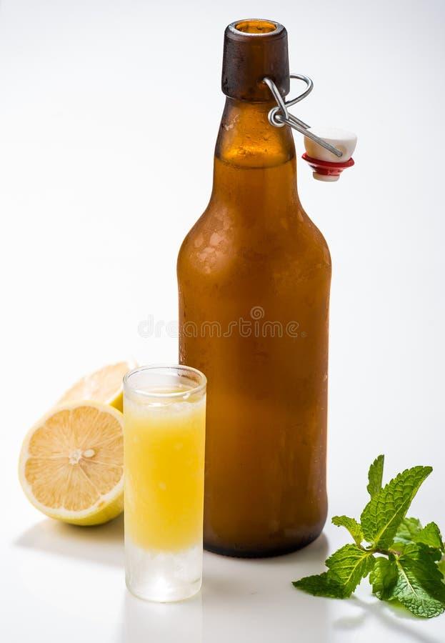 Traditional homemade lemon liqueur limoncello and fresh citrus royalty free stock photography