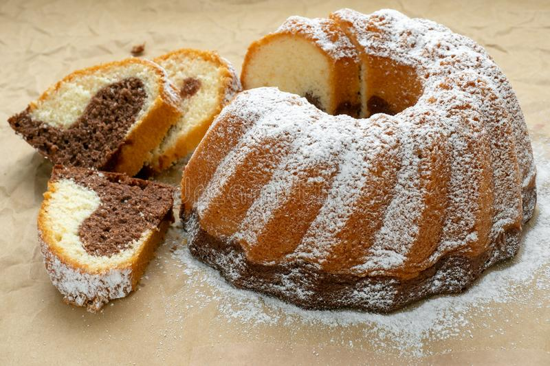 Traditional homemade marble cake. Sliced marble bundt cake royalty free stock photo