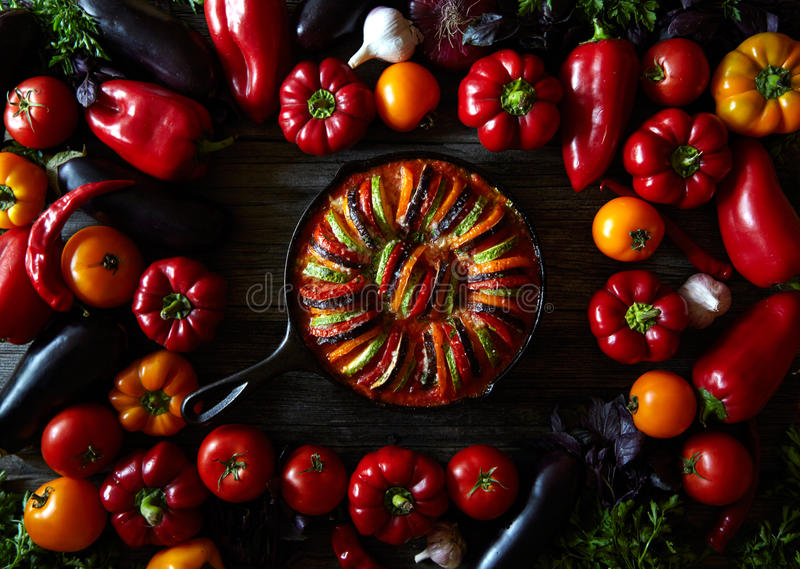 Traditional homemade ratatouille french vegetarian food vegetable. Assorted vegetables background. Top view. Traditional homemade vegetable ratatouille baked in royalty free stock images