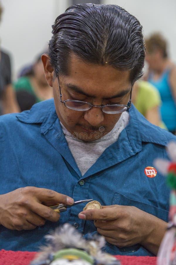 Traditional Hopi Kachina Doll Artist Showing Work stock photography