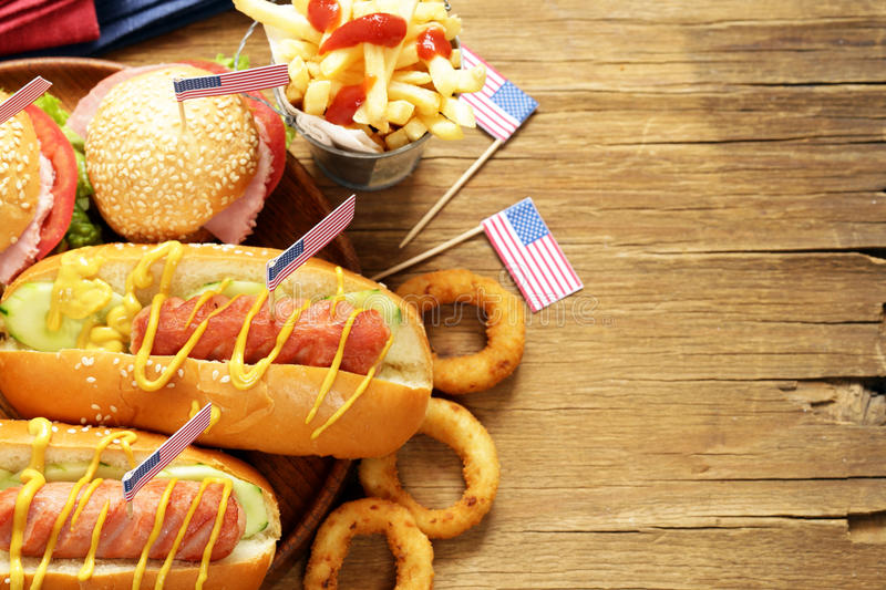 Traditional hot dog, french fries and onion rings food for the celebration of July 4. Independence Day of America royalty free stock photo
