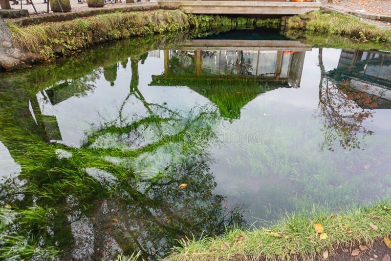 Traditional house with beautiful spring garden at Oshino Hakkai village royalty free stock image