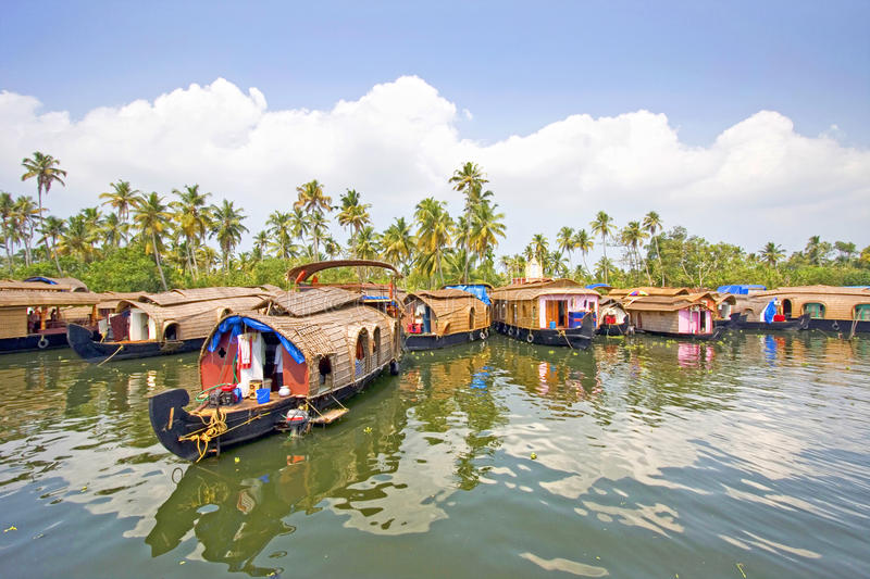 Traditional House boats, Alleppey, Kerala, India. Traditional House boats moored together along the banks of the backwaters of Alleppey, Kerala, India royalty free stock images