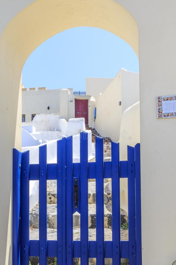 Traditional house entrance in street of Thira in Santorini, Greece royalty free stock photo