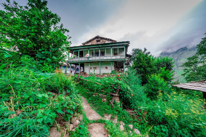 A traditional house in himalayas, sainj valley, kullu, himachal pradesh, india. Photo of traditional house in himalayas, sainj valley, kullu, himachal pradesh royalty free stock image