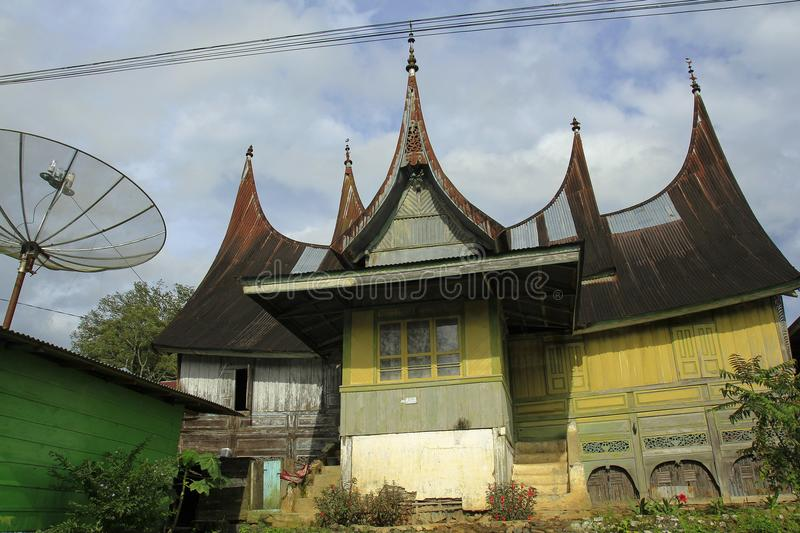 Minang Traditional House. 08/01/2017, West Sumatera, Indonesia: One of the resident houses with Minang architectural style that began to be rare in the most royalty free stock image
