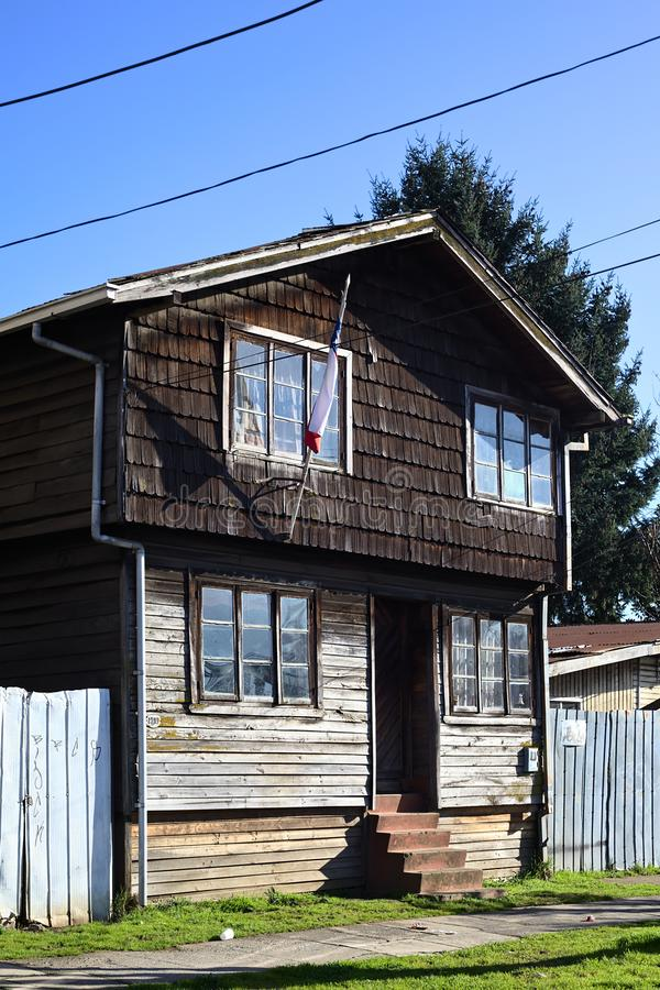 Traditional House with Shingles in Osorno, Chile. OSORNO, CHILE - SEPTEMBER 12, 2015: House built in traditional way with wooden shingle in the city of Osorno stock photo