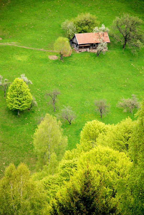 Download Traditional House On A Spring Hill Stock Photo - Image of hill, hike: 19528354