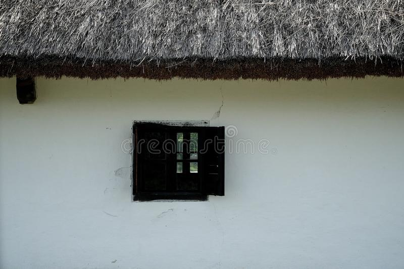 Traditional house with thatch roof. Traditional historic farm house with thatch roof and a window royalty free stock image