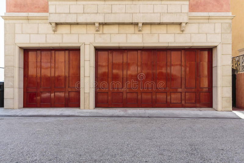 Traditional house with three car garage royalty free stock photography