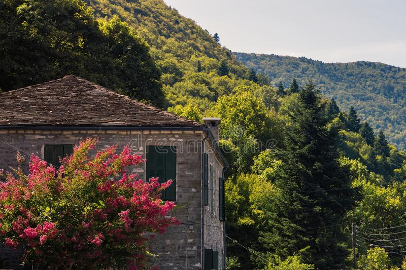 Traditional house and village in the mountain in Greece in the Zagoria region. National park of Pindus mountain stock photo