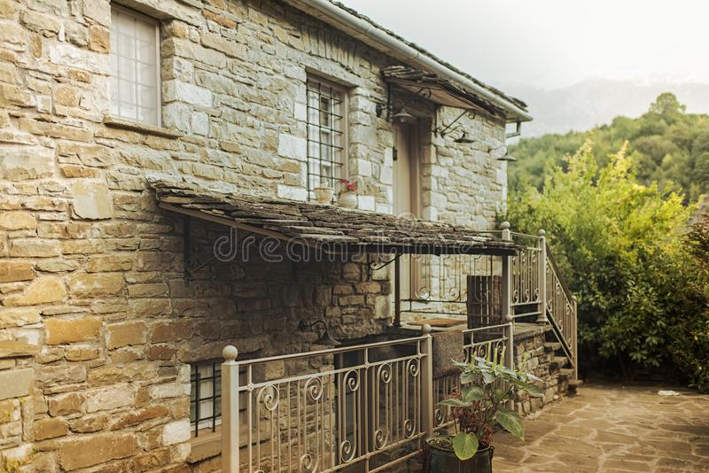 Traditional house and village in the mountain in Greece in the Zagoria region. National park of Pindus mountain stock photos