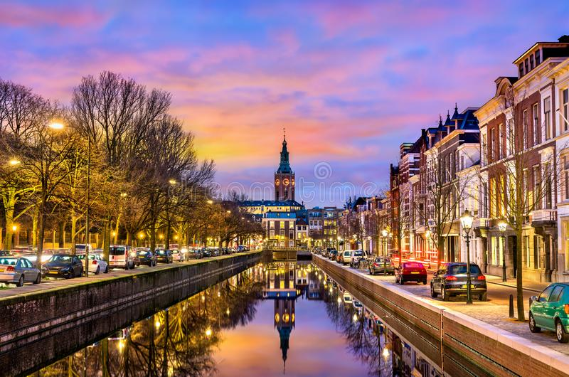 Traditional houses beside a canal in the Hague, the Netherlands royalty free stock photography