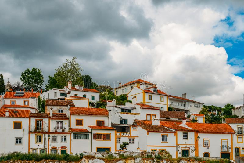 Traditional houses in Constancia, Portugal. View of traditional limestone cozy yellow and white houses at Constancia in the Santarem District of Portugal stock photography