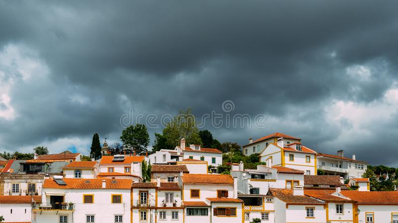 Traditional houses in Constancia, Portugal. View of traditional limestone cozy yellow and white houses at Constancia in the Santarem District of Portugal stock images