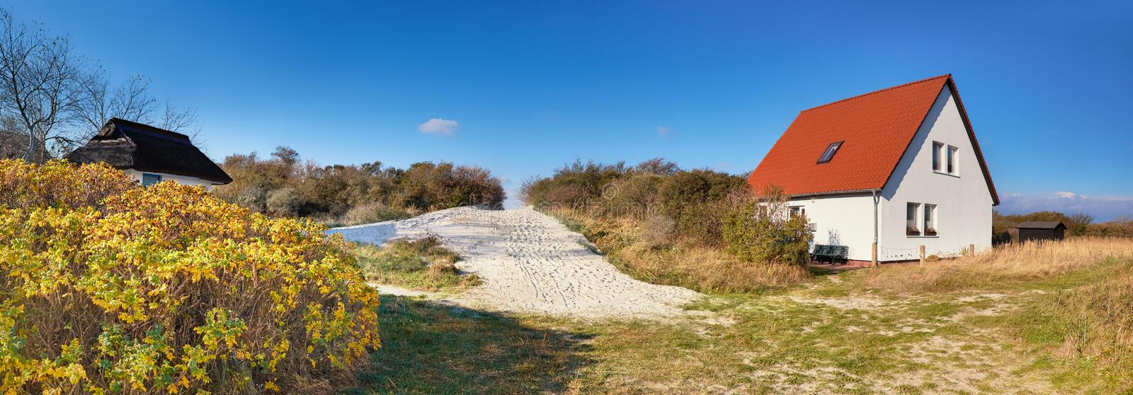 Traditional houses and entrance to the beach, Vitte village on island of Hiddensee, off the Baltic coast of Northern German. Y, panoramic image royalty free stock image