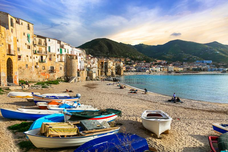 Sicily - old town Cefalu with fishing boats on the beach. Italy. Traditional houses and fishing boats in Cefalu,Sicily,Italy stock photos
