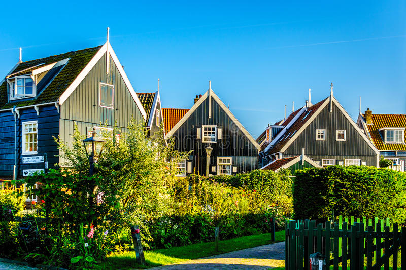 Traditional houses with green boarded wall and red tile roof in the small historic fishing village of Marken royalty free stock photo