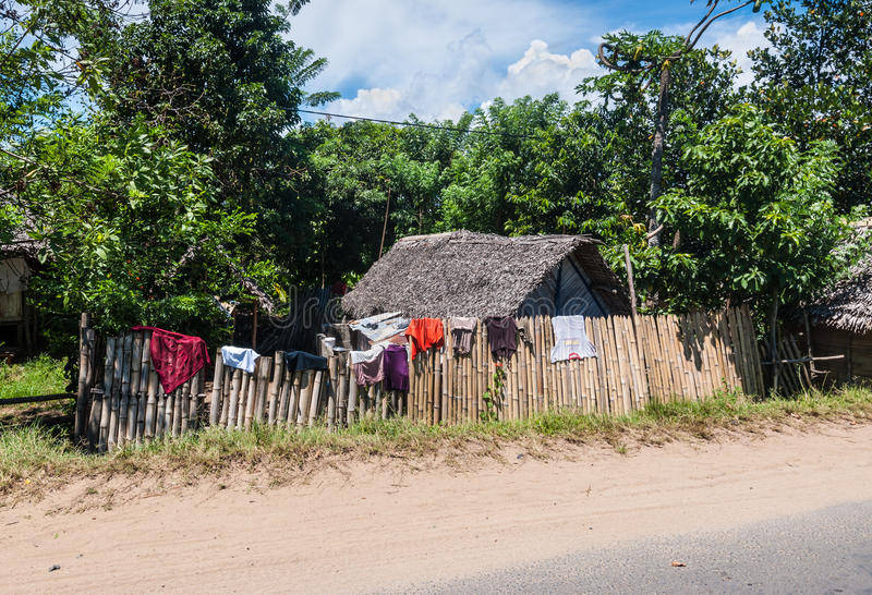 Traditional houses in Madagascar. Toamasina, Madagascar - December 22, 2017: Traditional houses in Madagascar`s countryside near Toamasina Tamatave, Madagascar stock photo